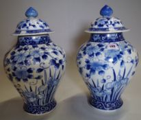A pair of Asian blue and white large lidded vases, (2).
