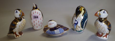 A group of five Royal Crown Derby imari pattern paperweights, comprising; two penguins,