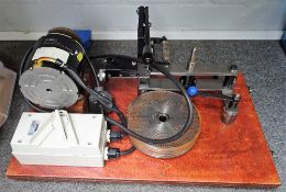 A Chronos wheel-cutting machine With five steel discs,