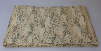 A Chinese silk embroidered altar panel, early 20th century, worked in green,