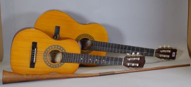 A B&M London acoustic guitar, an encore half size acoustic guitar and a copper hunting horn, (qty).