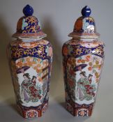 A pair of 20th century Imari style vases and cover of tapering octagonal form, 46cm high, (2).