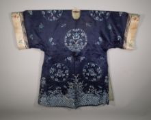 A Chinese silk blue ground robe with all over foliate decoration.