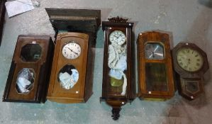 A group of 19th century and later mahogany and oak wall clocks, (a.f.).