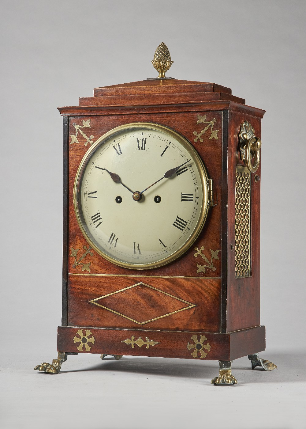Lot 677 - A Regency gilt brass-mounted mahogany and cut brass-inlaid bracket clock The chamfer top with