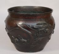A Chinese bronze jardiniere, 20th century, relief cast with wild birds amongst prunus blossom,