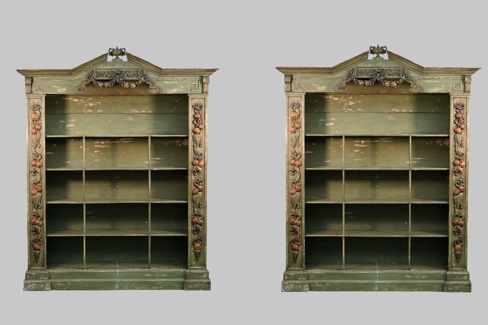 Lot 1866 - A pair of Baroque revival green painted floor standing open bookcases,