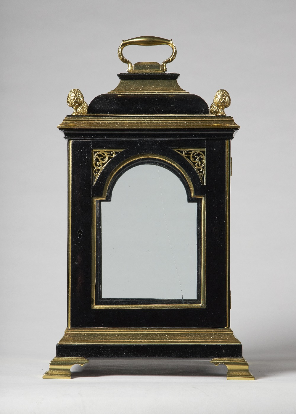 Lot 655 - A gilt brass-mounted inverted bell-top bracket clock case In the George III style incorporating