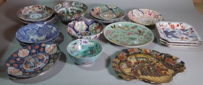 A quantity of 20th century decorative Chinese plates and bowls of varying patterns and styles,