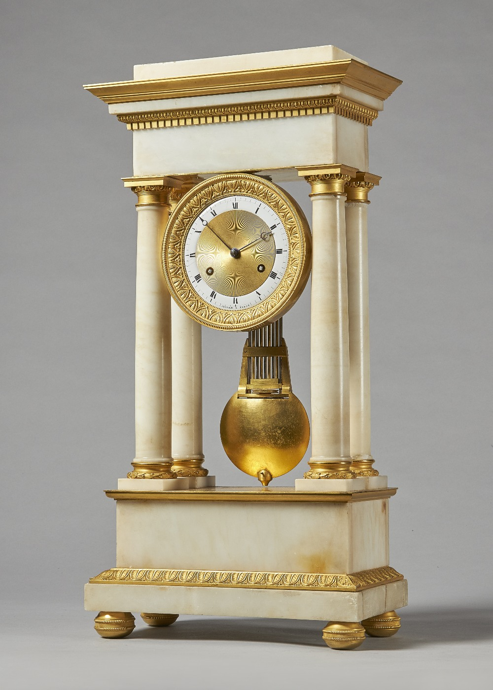 Lot 699 - An Empire ormolu and white marble portico clock By Gérard,