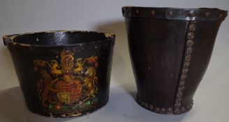 An 18th century leather fire bucket with painted Coat of Arms 34cm high and another.