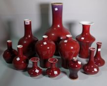 Asian ceramics, a quantity of 20th century red glazed vases of various forms, the largest 42cm high.
