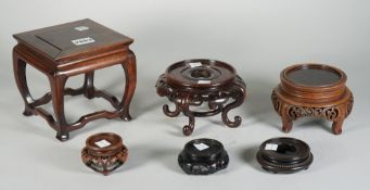 A group of six Chinese hardwood stands, 2.5cm to 14cm high, (6).