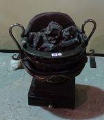 A Regency style steel and iron pedestal fire basket.