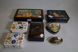A group of 20th century hand painted lacquer boxes, mostly Russian and two inlaid stone boxes.