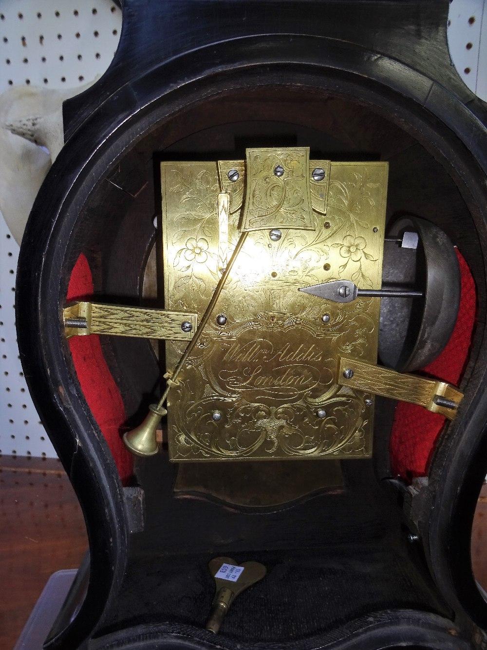 Lot 663 - A George III giltmetal-mounted ebonised striking balloon clock By William Addis,