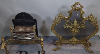 A Regency style electric fire grate with brass dog finials, 63cm wide x 77cm high,