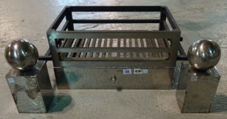 Chesneys; A 'Soho' fire grate with chromed spherical fire dogs and front plate, 66cm wide overall.