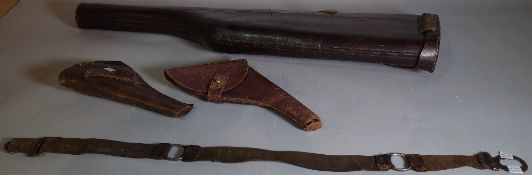 An early 20th century shotgun leather case, 79.