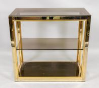 A dwarf gilt metal frame set of display shelves, with a smoked plate glass shelf,