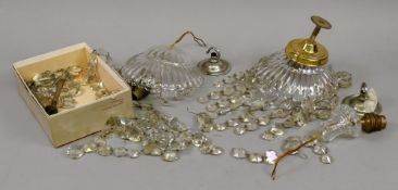 A pair of glass pendant light fittings h