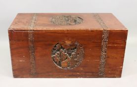 A Chinese carved camphorwood chest, firs