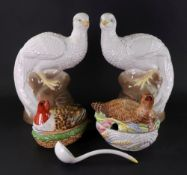 A pair of Studio pottery figures of peacocks, 20th century, perched on rock work, 27cm high,