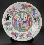 A Canton famille rose dish, mid 19th century, painted with a central figurative panel,