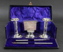 A cased Edwardian silver desk set, Asprey, Birmingham 1908 & 1912,