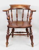 A Victorian smokers bow mahogany elbow chair, with scrolled arms, baluster turnings, solid seat,