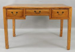 A Chinese hardwood desk, with three frieze drawers, on moulded square legs,