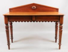 A Victorian mahogany hall table, circa 1890, the arched back centred by a turned roundel,