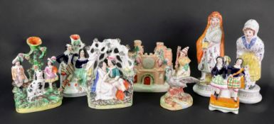 A collection of eight Victorian Staffordshire pottery figures including Red Riding Hood and Mother