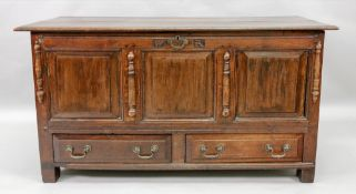 A mid 18th century oak mule chest, of raised and fielded panelled construction,