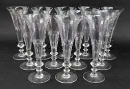 A set of twelve William Yeoward glass champagne flutes,