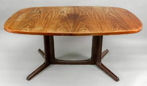 Gudme Mobelfabrik; a rosewood dining table, the rounded banded rectangular top with two leaves,