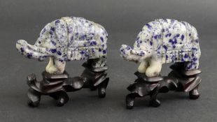 A pair of Chinese lapis lazuli figures of standing elephants, 20th century, 9cm long,