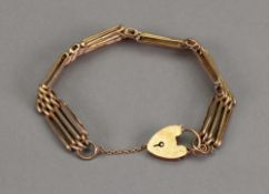 A yellow precious metal fancy four-bar gate-link bracelet,