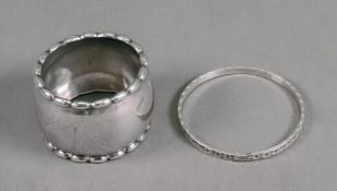Georg Jensen; a circular napkin ring, detailed 925 S 30-A, with oval bead borders, 4cm diameter,