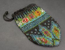 A Victorian bead work purse, 20cm long.