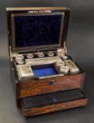A Victorian brass bound coromandel wood toilet box,
