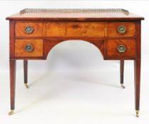 A George III mahogany boxwood and ebony strung dressing table,