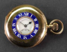 An 18ct gold cased half hunter keyless wind pocket watch, the white enamelled dial,