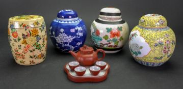 A Chinese Yixing stoneware miniature part tea service, 20th century, comprising; a tray,