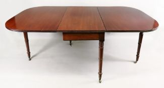 A George III mahogany drop leaf dining table, the deep hinged rounded leaves with reeded edge,