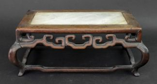 A Chinese rosewood rectangular stand, 19th/early 20th century, the top inset with grey marble,