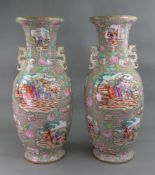 An unusual and large pair of Staffordshire earthenware two handled baluster vases,