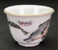 A Chinese porcelain tea bowl, 20th century, the exterior painted with fish and crustacea, 4.