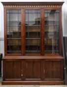 A reproduction George III style mahogany library bookcase,