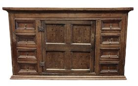 A late 17th century oak food cupboard, altered, of panelled construction,